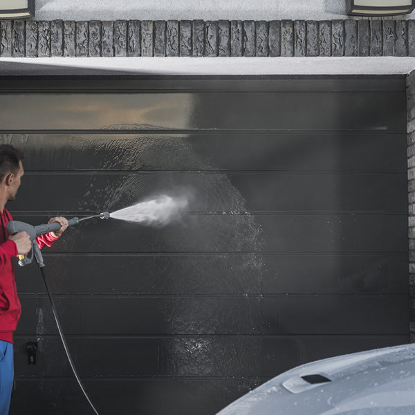 Spray your garage door with some soap and water, and you'll be surprised just how fresh it looks afterwards.